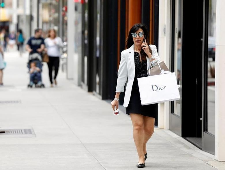 A shopper talks on her mobile phone in Beverly Hills, U.S., May 17, 2016.   REUTERS/Mario Anzuoni
