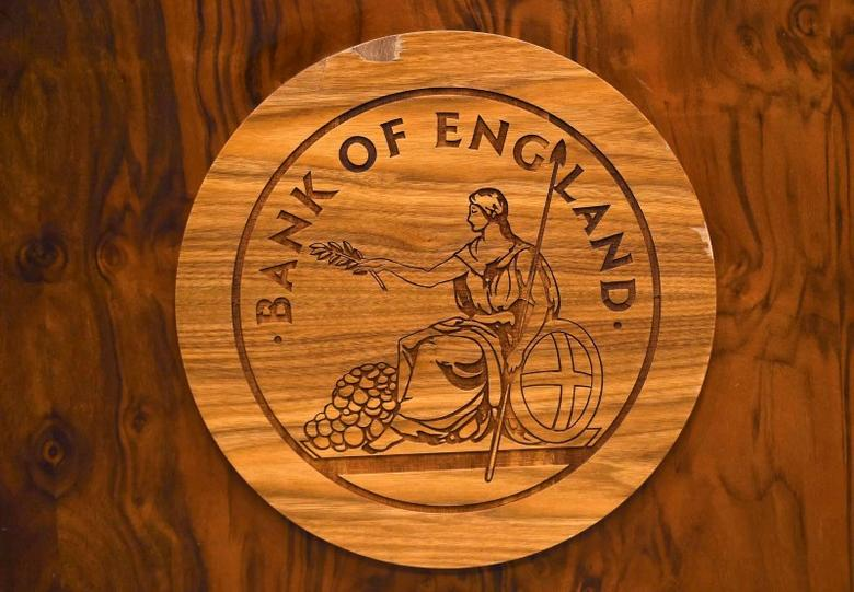 A wooden carving of the Bank of England logo is seen on a desk during a news conference at the Bank of England in London, Britain July 5, 2016. REUTERS/Dylan Martinez/File Photo
