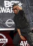 Hip hop artist Travis Scott gestures as he arrives at the 2015 BET Awards in Los Angeles, California June 28, 2015.  REUTERS/Phil McCarten