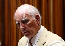 Former Grand Slam doubles champion Bob Hewitt looks on ahead of court proceedings at the  South Gauteng High Court in Johannesburg February 10, 2015. Hewitt was found guilty by a South African court on March 23, 2015, of two charges of rape and one charge of sexual assault of minors, the radio station Eyewitness News said. REUTERS/Siphiwe Sibeko