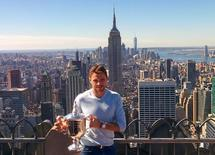 Stan Wawrinka of Switzerland, winner of the 2016 U.S. Open tennis tournament poses with the trophy  in Manhattan, New York, U.S., September 12, 2016.  REUTERS/Tony Pyle
