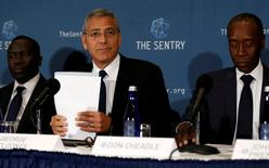 George Clooney (C), with fellow actor Don Cheadle (R) and The Sentry investigative journalist Brian Adeba (L), discuss The Sentry's investigation of the role of national corruption in the ongoing humanitarian crisis in South Sudan during a news conference at the National Press Club in Washington, U.S. September 12, 2016. REUTERS/Jonathan Ernst