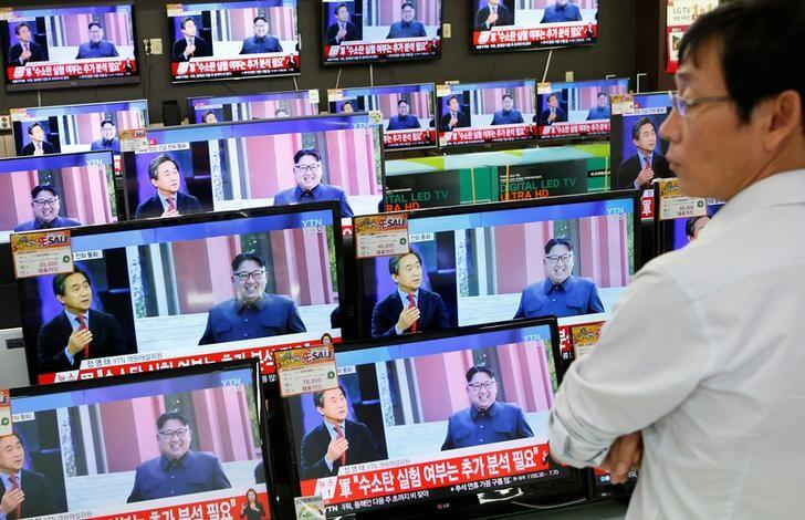 A sales assistant watches TV sets broadcasting a news report on North Korea's fifth nuclear test, in Seoul, South Korea, September 9, 2016.  REUTERS/Kim Hong-Ji