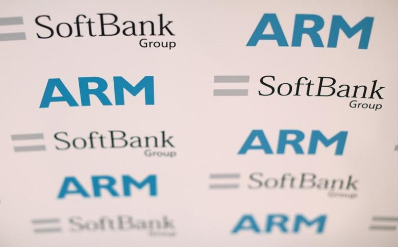 An ARM and SoftBank Group branded board is displayed at a news conference in London, Britain July 18, 2016. Picture taken July 18, 2016. REUTERS/Neil Hall/File Photo
