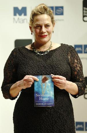 Deborah Levy, one of the shortlisted authors for the 2012 Man Booker Prize, poses with her book ''Swimming Home'', in London October 15, 2012. REUTERS/Luke MacGregor/File Photo
