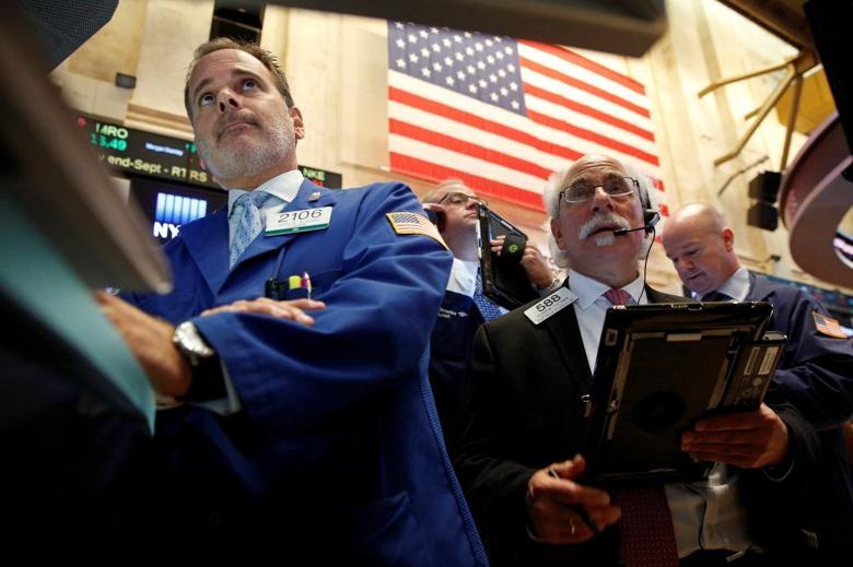 Traders work on the floor of the New York Stock Exchange (NYSE) in New York City, New York, U.S., September 9, 2016. REUTERS/Brendan McDermid