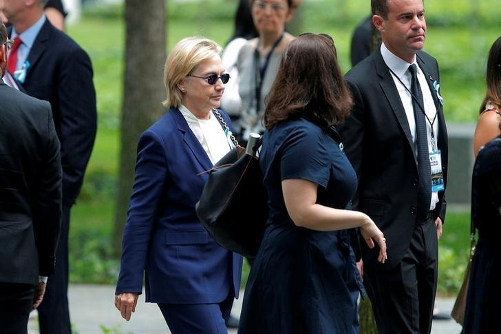 Democratic presidential candidate Hillary Clinton arrives for ceremonies to mark the 15th anniversary of the September 11 attacks at the National 9/11 Memorial in New York, September 11, 2016. REUTERS/Brian Snyder