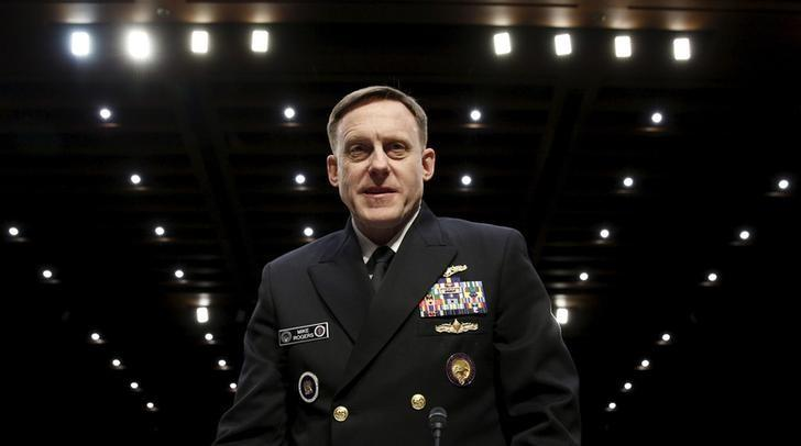 U.S. Navy Admiral Mike Rogers, commander of U.S. Cyber Command, arrives to testify at a hearing held by the Senate Armed Services on Capitol Hill in Washington April 5, 2016. REUTERS/Kevin Lamarque/File Photo