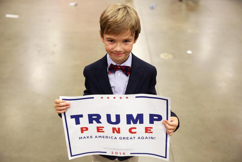 Cole Baird, 8, a supporter of Donald Trump, poses for a portrait following a campaign rally in Fredericksburg, Virginia. REUTERS/Carlo Allegri