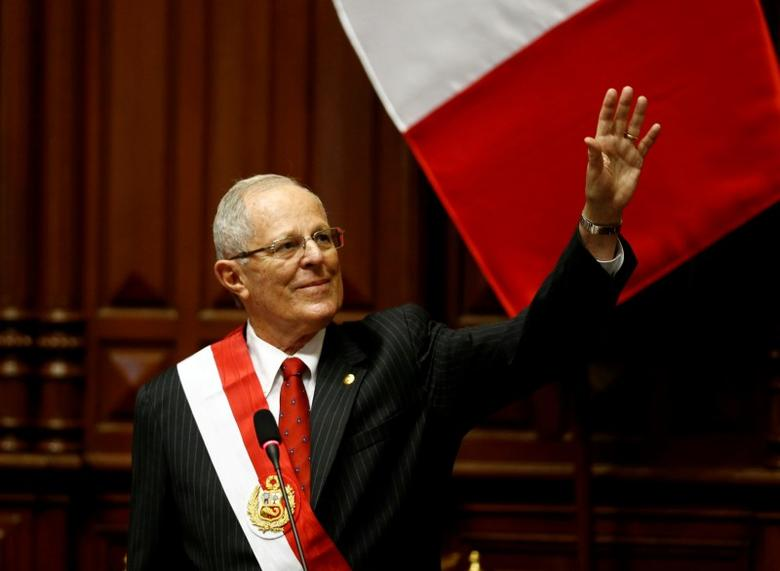 Peru's President Pedro Pablo Kuczynski waves to the audience after receiving the presidential sash during his inauguration ceremony in Lima, Peru, July 28, 2016. REUTERS/Mariana Bazo