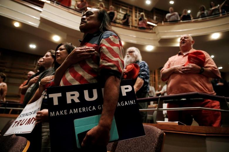 People stand for the U.S. national anthem before an appearance by Republican presidential nominee Donald Trump at a campaign town hall meeting in Virginia Beach, Virginia, U.S., September 6, 2016.  REUTERS/Mike Segar