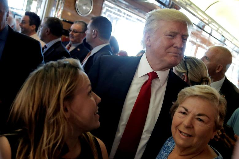 Republican presidential nominee Donald Trump makes his way through a crowd of supporters during a campaign stop at the Boulevard Diner in Dundalk, Maryland, U.S., September 12, 2016.  REUTERS/Mike Segar