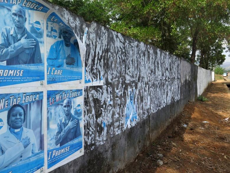 Ebola awareness posters are seen peeling off the wall in Freetown, Sierra Leone, January 20, 2016. REUTERS/Umaru Fofana