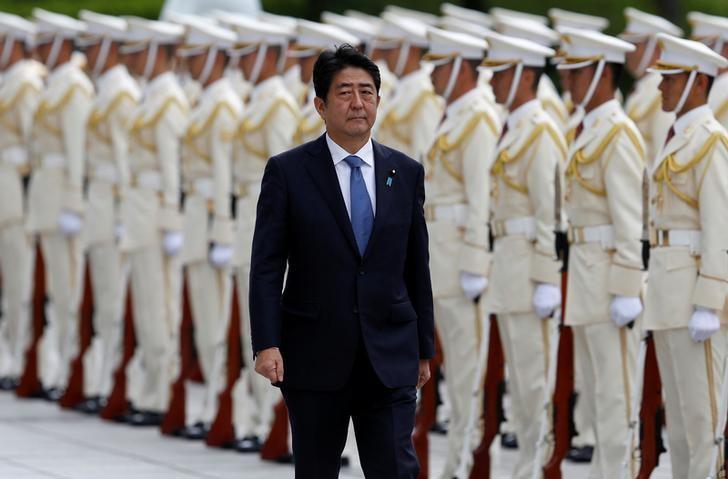 Japan's Prime Minister Shinzo Abe reviews the honour guard before a meeting with Japan Self-Defense Force's senior members at the Defense Ministry in Tokyo, Japan, September 12, 2016. REUTERS/Toru Hanai/Files