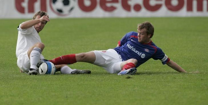 Christian Grindheim (R) of Valerenga IF fights for ball with FC Flora's Martin Reim during their UEFA Cup first round qualification soccer match in Tallinn July 19, 2007. REUTERS/Ints Kalnins/File Photo