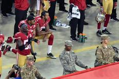 Sep 12, 2016; Santa Clara, CA, USA; (Editors note: Caption correction) San Francisco 49ers quarterback Colin Kaepernick and teammate 49ers free safety Eric Reid (35) kneel during the playing of the national anthem before a NFL game against the Los Angeles Rams at Levi's Stadium. Mandatory Credit: Kirby Lee-USA TODAY Sports