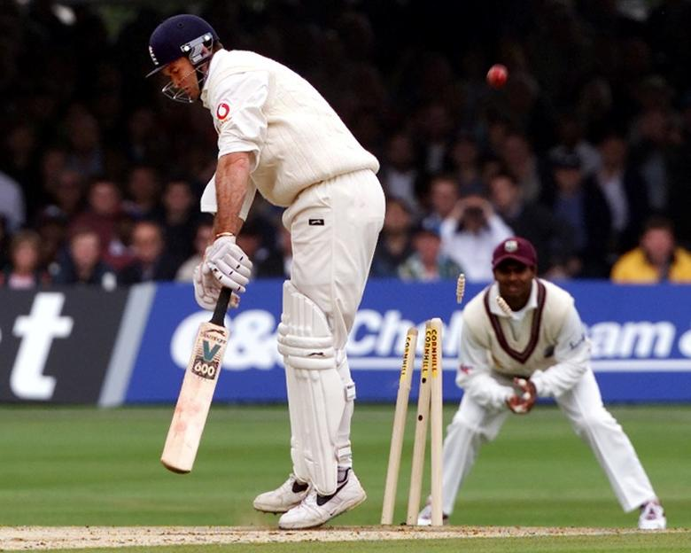England batsman Graeme Hick is bowled by West Indian bowler Curtley Ambrose during the second Test at Lord's June 30, 2000. REUTERS