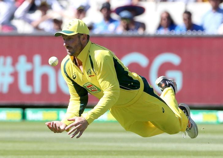 Australia's Shaun Marsh dives to collect a skied shot from India's Virat Kohli on the first bounce during their One Day cricket match at the Melbourne Cricket Ground January 17, 2016. REUTERS/Hamish Blair/Files