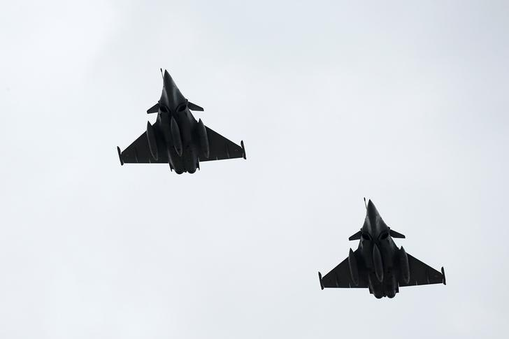Dassault Rafale fighter jets fly over the Pyramid of the Louvre Museum as part of a rehearsal of the traditional Bastille Day military parade in Paris, France, July 11, 2016. REUTERS/Benoit Tessier/Files