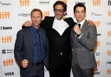 "Director Ben Younger poses with actors Miles Teller (R) and Aaron Eckhart (L) as they arrive on the red carpet for the film ""Bleed for This"" during the 41st Toronto International Film Festival (TIFF), in Toronto, Canada, September 12, 2016.    REUTERS/Mark Blinch"