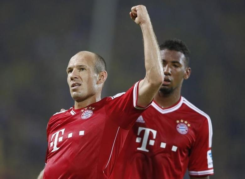 Bayern Munich's Arjen Robben celebrates his goal together with Jerome Boateng (R) against Borussia Dortmund during their SuperCup 2013 soccer match in Dortmund July 27, 2013. REUTERS/Wolfgang Rattay