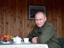 Vladimir Putin looks on during a meeting with Dmitry Medvedev on Lipno Island. Sputnik/Kremlin/Alexei Druzhinin/via REUTERS