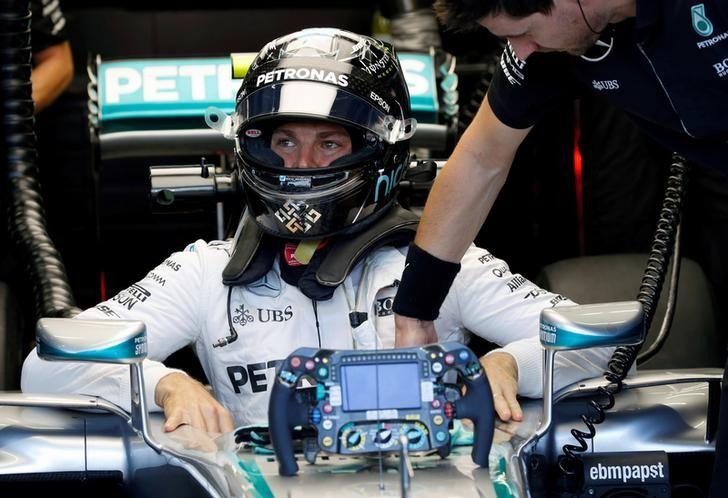 Formula One - Singapore Grand Prix - Marina Bay, Singapore - 16/9/16 Mercedes' Nico Rosberg of Germany gets into his car during first practice. REUTERS/Edgar Su
