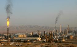 Le secrétaire général de l'Organisation des pays exportateurs de pétrole (Opep) Mohammed Barkindo devrait arriver samedi à Alger pour des discussions en vue d'une réunion programmée des membres de l'Opep dans la capitale algérienne d'ici la fin du mois. /Photo d'archives/REUTERS/Thaier al-Sudani