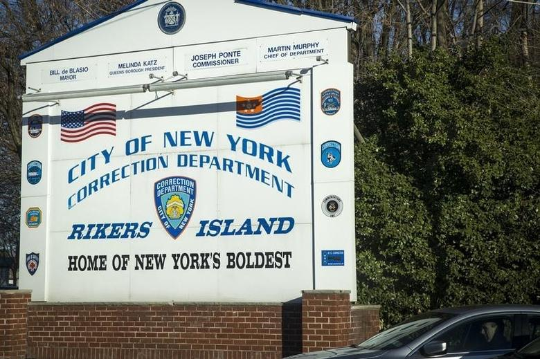 A car exits the Rikers Island Correctional facility in New York March 12, 2015. REUTERS/Brendan McDermid