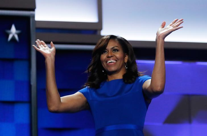U.S. first lady Michelle Obama waves as she appears onstage during the first session at the Democratic National Convention in Philadelphia, Pennsylvania, U.S., July 25, 2016. REUTERS/Jim Young/File Photo