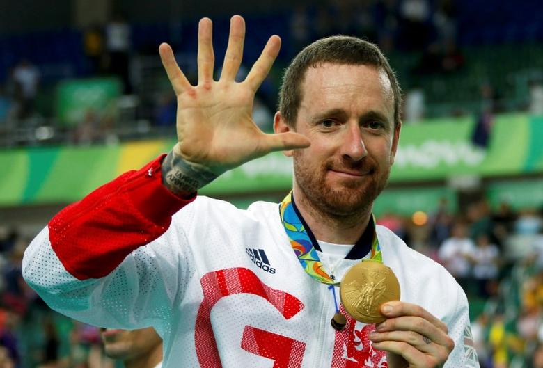 2016 Rio Olympics - Cycling Track - Victory Ceremony - Men's Team Pursuit Victory Ceremony - Rio Olympic Velodrome - Rio de Janeiro, Brazil - 12/08/2016. Bradley Wiggins (GBR) of Britain poses with his gold medal. REUTERSEric Gaillard/Files