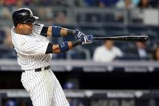 Sep 12, 2016; Bronx, NY, USA; New York Yankees second baseman Starlin Castro (14) hits a solo home run against the Los Angeles Dodgers during the second inning at Yankee Stadium. Mandatory Credit: Brad Penner-USA TODAY Sports