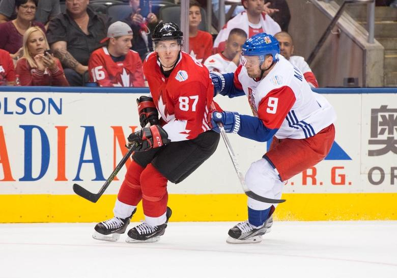 Sep 17, 2016; Toronto, Ontario, Canada; Team Canada  Sidney Crosby (87) battles for a puck with Team Czech Republic Milan Michalek (9) during the second period in the preliminary round play in the 2016 World Cup of Hockey at Air Canada Centre. Team Canada won 6-0. Mandatory Credit: Nick Turchiaro-USA TODAY Sports