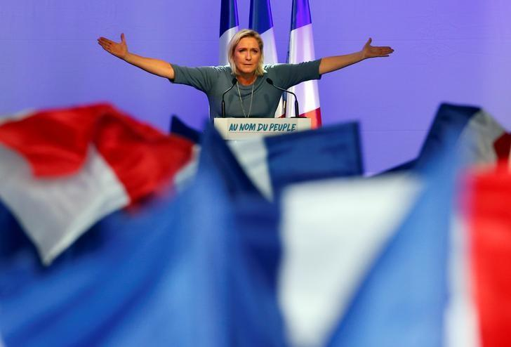 Marine Le Pen, French National Front (FN) political party leader, gestures during an FN political rally in Frejus, France, September 18, 2016. REUTERS/Jean-Paul Pelissier