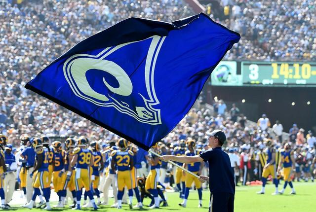 Sep 18, 2016; Los Angeles, CA, USA; Los Angeles Rams flags are waved on the field after a score in the second half of the game against the Seattle Seahawks at the Los Angeles Memorial Coliseum. Rams won 9-3.  Mandatory Credit: Jayne Kamin-Oncea-USA TODAY Sports