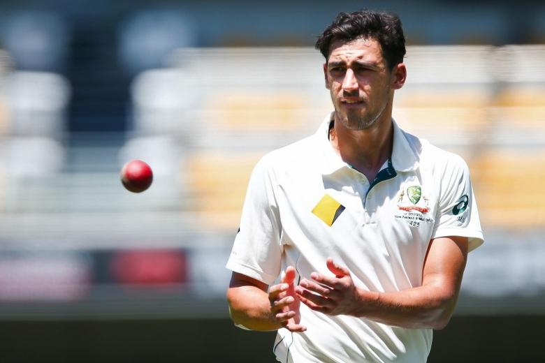 Australian bowler Mitchell Starc receives the ball, during the first cricket test match between Australia and New Zealand in Brisbane November 7, 2015. REUTERS/Patrick Hamilton