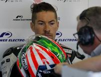 Honda MotoGP rider Nicky Hayden (L) of the U.S. talks with a team member in his garage during a free practice session at the Twin Ring Motegi circuit ahead of Sunday's Japanese Grand Prix in Motegi, north of Tokyo, Japan, October 9, 2015. REUTERS/Issei Kato