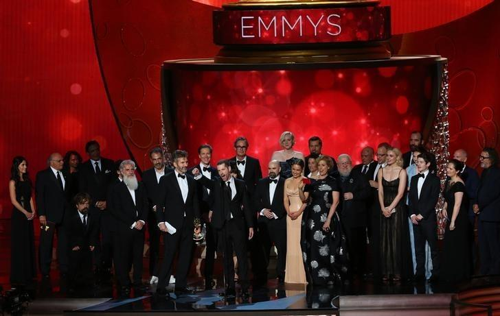 Executive Producers David Benioff, center left, and D.B. Weiss accept the award for Oustanding Drama Series for ''Game of Thrones'' with the cast and crew at the 68th Primetime Emmy Awards in Los Angeles, California, U.S., September 18, 2016.  REUTERS/Mike Blake