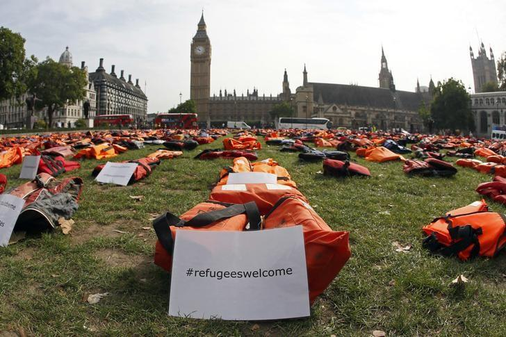 A display of lifejackets worn by refugees during their crossing from Turkey to the Greek island of Chois,  are seen Parliament Square in central London, Britain September 19, 2016. The display was organised by a number of charities and refugees to help focus attention of the UN summit on Addressing Large Movements of Refugees and Migrants.  REUTERS/Stefan Wermuth