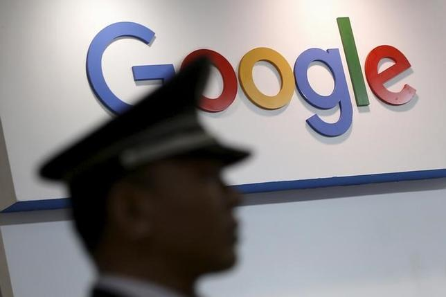 A security guard keeps watch as he walks past a logo of Google at an exhibition stage during the 4th China (Shanghai) International Technology Fair 2016 in Shanghai, China, April 21, 2016. REUTERS/Aly Song