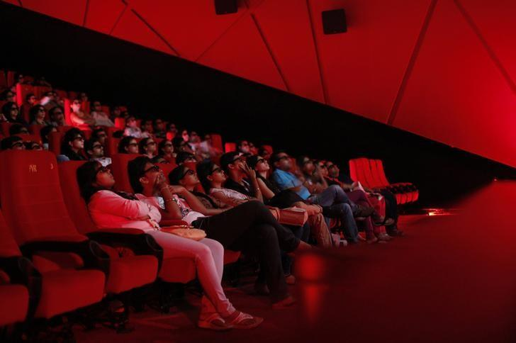 Cinema-goers wearing 3D glasses watch a movie at a PVR Multiplex in Mumbai November 10, 2013. REUTERS/Danish Siddiqui/File Photo