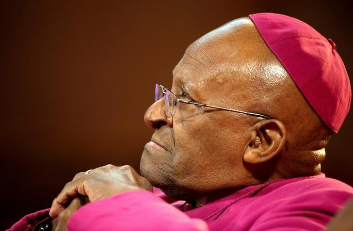 The former Anglican archbishop of Cape Town Desmond Tutu waits to receive the 2013 Templeton Prize at the Guildhall in central London on May 21, 2013.  REUTERS/Paul Hackett/File Photo