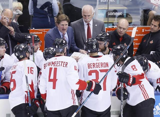 Sep 20, 2016; Toronto, Ontario, Canada; Team Canada head coach Mike Babcock (left) and assistant coach Joel Quenneville (right) address the players during a break in the action against Team USA of preliminary round play in the 2016 World Cup of Hockey at Air Canada Centre. Team Canada defeated Team USA 4-2. Mandatory Credit: John E. Sokolowski-USA TODAY Sports