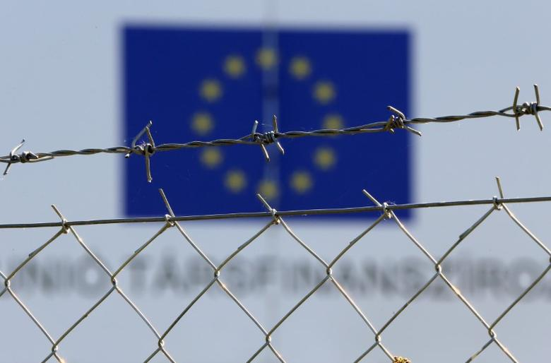 A fence is pictured in front of an open migrant camp in Vamosszabadi, Hungary, August 30,2016.  REUTERS/Laszlo Balogh