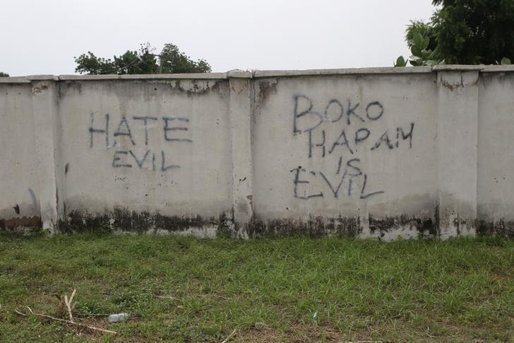 Writings describing Boko Haram are seen on the wall along a street in Bama, in Borno, Nigeria August 31, 2016. REUTERS/Afolabi Sotunde/File Photo