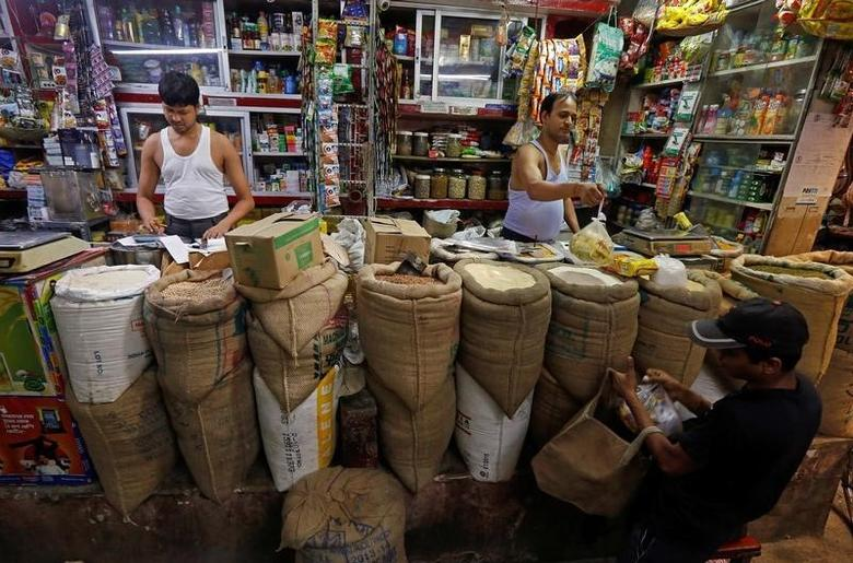 A shopkeeper sells groceries to a customer at his shop in Kolkata, India, September 12, 2016. REUTERS/Rupak De Chowdhuri