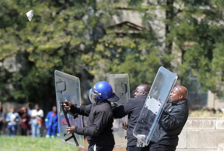 Students throw stones during clashes with security at Johannesburg's University of the Witwatersrand. Demonstrations this year and in 2015 over the cost of university education -- prohibitive for many black students -- have highlighted frustration at the inequalities that persist more than two decades after the 1994 end of white minority rule.REUTERS/Siphiwe Sibeko