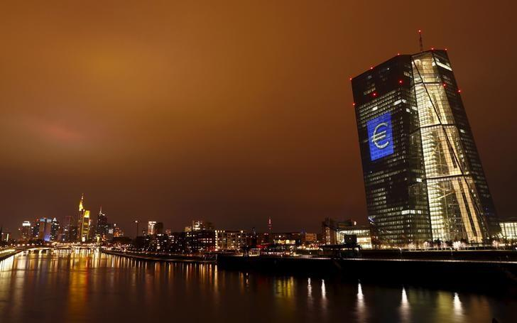 The head quarter of the European Central Bank (ECB) is illuminated with a giant euro sign at the start of the ''Luminale, light and building'' event in Frankfurt, Germany, March 12, 2016. REUTERS/Kai Pfaffenbach/Files