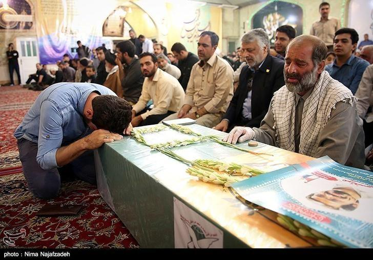 Mourners gather around the bodies of Iranians killed in Syria, during their funeral in Mashad, Iran in this handout photo obtained by Reuters September 21, 2016.  Tasnim News Ageny/Handout via REUTERS