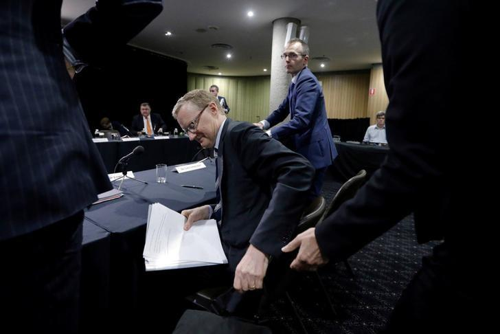 Australia's new Reserve Bank of Australia (RBA) Governor Philip Lowe gets up from his chair after speaking at a parliamentary economics committee meeting in Sydney, September 22, 2016.      REUTERS/Jason Reed